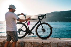 Bike mechanic is cleaning a road bike during the Rad Race