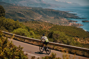 Road cyclist on a winding road in the Peloponnese